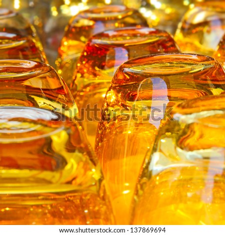 Beautiful bright yellow glasses for drink  background