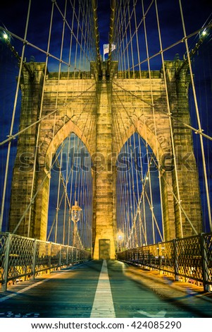 Beautiful Brooklyn Bridge in New York City lit up at night - stock photo