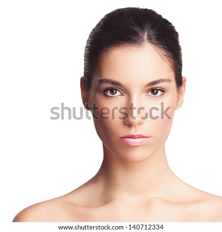 Beautiful brown-eyed woman posing topless in front of a white background. - stock photo