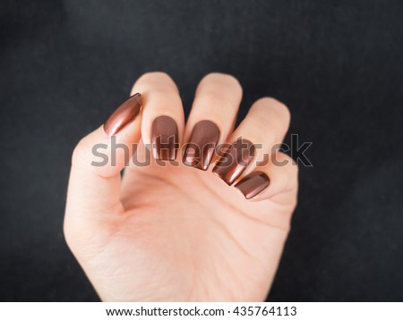 Beautiful brown nails. Bronze manicure