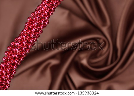 beautiful brown satin with red necklace - stock photo