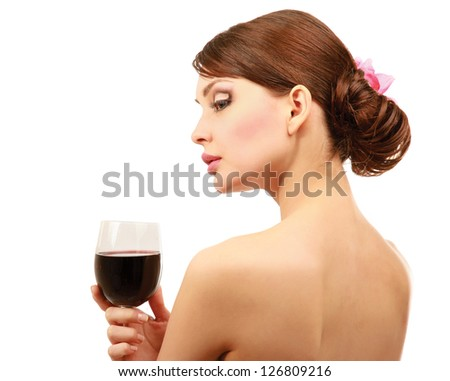 Beautiful brunet girl drinking red wine isolated on white background