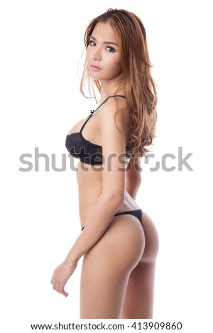 Beautiful brunette asian woman with nice body and buttocks in lingerie or thong, isolated on white background - stock photo