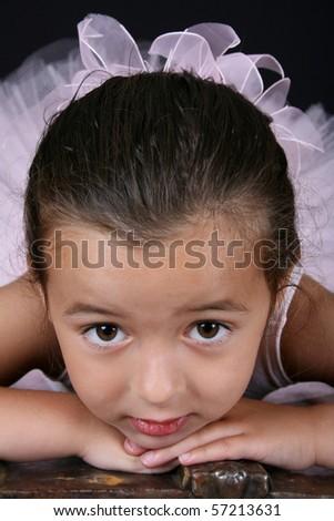 Beautiful brunette ballet girl lying on her tummy - stock photo
