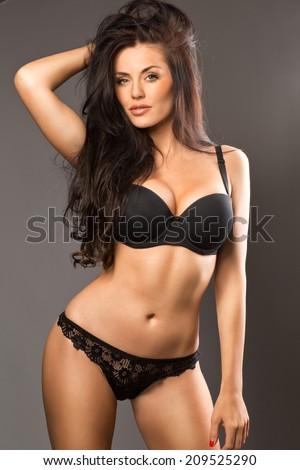 Beautiful brunette beauty in black underwear - stock photo
