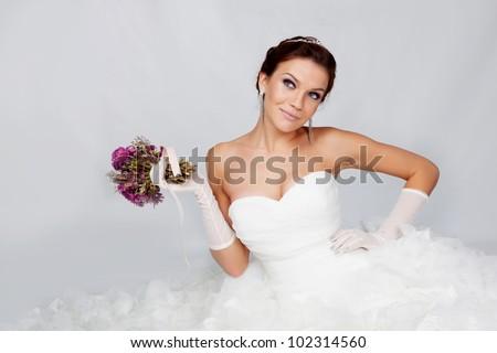 Beautiful brunette bride portrait in studio - stock photo