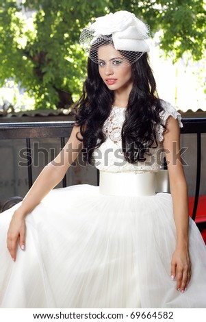 Beautiful  brunette bride posing on her wedding day - stock photo