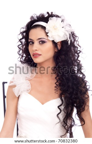 Beautiful Brunette Bride with long curly hair and flower smiling. Isolated on White - stock photo