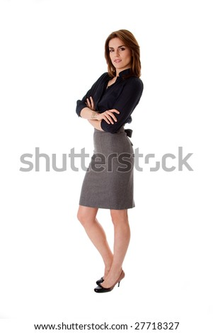 Beautiful brunette business woman standing wearing gray skirt and blue blouse with arms crossed, isolated