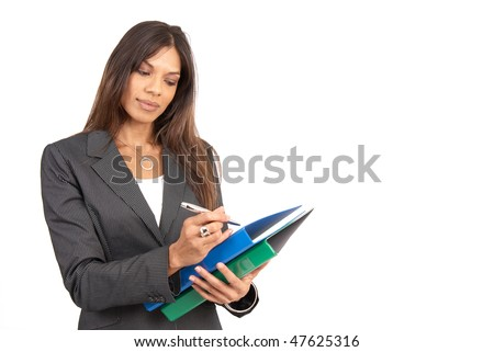 Beautiful brunette businesswoman in pinstripe suit holding a pen and folders. Isolated on white background with copy space - stock photo