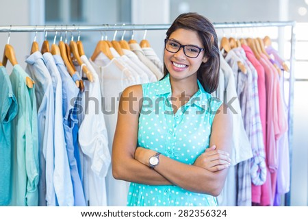 Beautiful brunette doing shopping in clothes store - stock photo