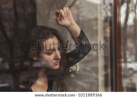 Girl Behind The Glass