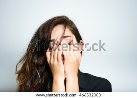beautiful brunette girl crying in black, isolated on white background