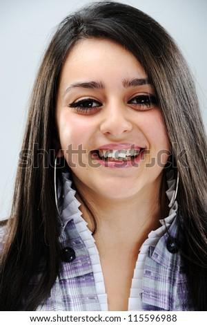 Beautiful brunette girl face smiling - stock photo