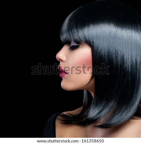 Beautiful Brunette Girl. Healthy Black Hair. Isolated on Black background. Beauty Woman with Short Black Hair.  - stock photo