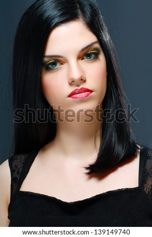 Beautiful Brunette Girl. Healthy Long Hair and Holiday Makeup - stock photo