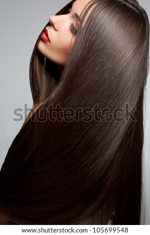 Beautiful Brunette Girl. Healthy Long Hair.  High quality image. - stock photo