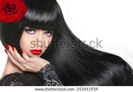 Beautiful Brunette Girl. Healthy Long Hair. Makeup. Manicured nails. Red lips. Fashion attractive young woman with rose hairstyle.  - stock photo
