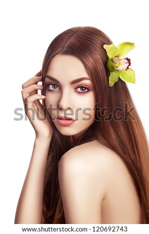 Beautiful Brunette Girl. Healthy Long Hair with Orchid - Spa concept