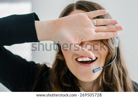 beautiful brunette girl in headphones with a microphone closes her eyes - stock photo