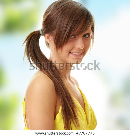 Beautiful brunette girl in yellow dress. - stock photo