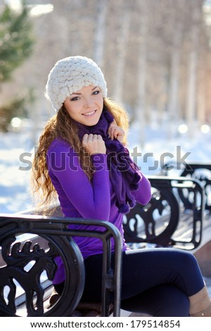 Beautiful brunette girl on a walk in winter - stock photo