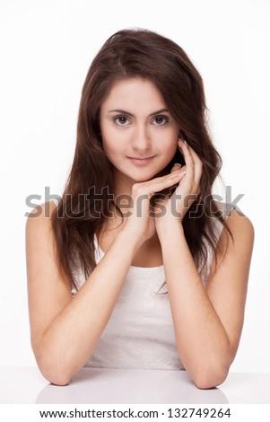Beautiful brunette girl on white background - stock photo