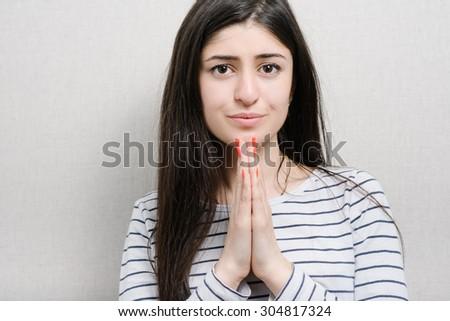 beautiful brunette girl praying - stock photo