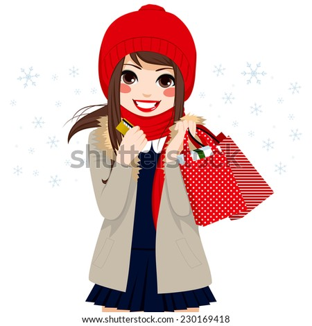 Beautiful brunette girl shopping on Christmas winter day holding credit card and bags full of gifts and presents - stock photo