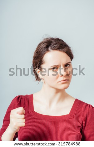 beautiful brunette girl shows fig - stock photo