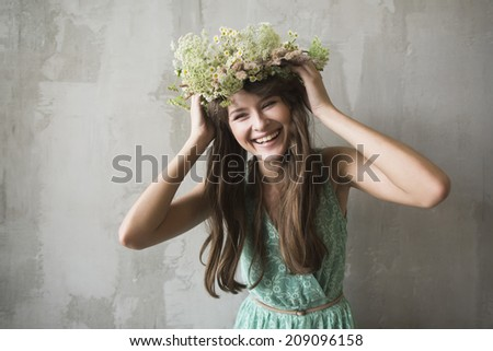beautiful brunette girl with a wreath in her hair - stock photo