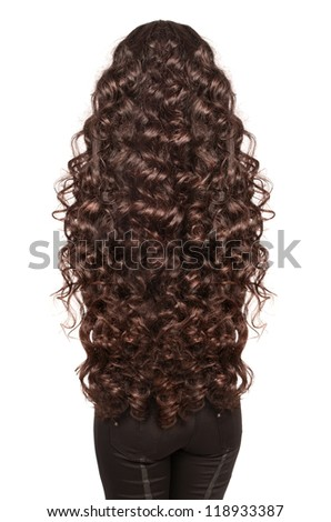 Beautiful Brunette Girl with extra long curly healthy dark Hair. Isolated portrait of woman with gorgeouse hairstyle in studio on whit background