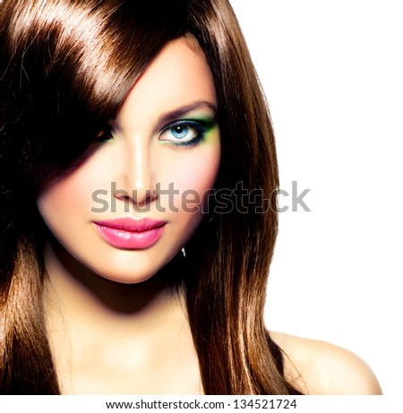 Beautiful Brunette Girl with Healthy Long Brown Hair and Blue Eyes. Beauty Model Woman with Professional Makeup. Hairstyle. Stylish Haircut. Fringe. Glossy Smooth Fashion Hair. Extensions - stock photo