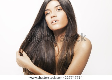 Beautiful Brunette Girl with Healthy Long Hair. Hair and beauty concept. High quality image. Studio shot, horizontal. - stock photo