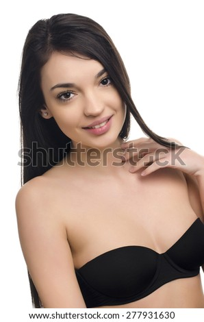 Beautiful brunette girl with long hair. Beauty portrait. Portrait of a young attractive brunette woman smiling. Isolated on white. - stock photo