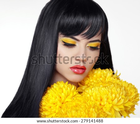 Beautiful brunette girl with long straight glossy hair and Makeup with yellow flowers isolated on white background. - stock photo
