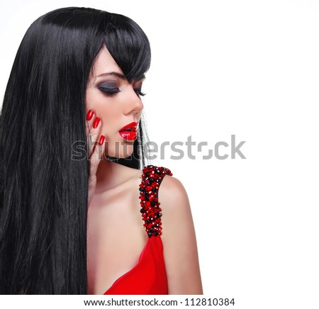Beautiful Brunette Girl with red lips and nail manicure isolated on white - stock photo