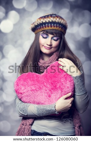 Beautiful brunette girl with toy heart. Photo for st. Valentine post card. - stock photo