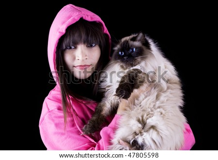 Beautiful brunette holding a Rag doll cat