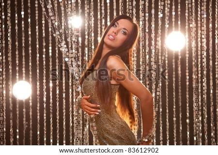 Beautiful brunette in a night club - stock photo