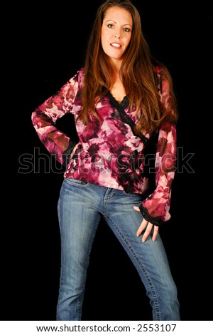 Beautiful brunette in jeans and heels. - stock photo