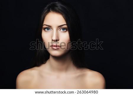 beautiful brunette in studio. portrait. skin care - stock photo