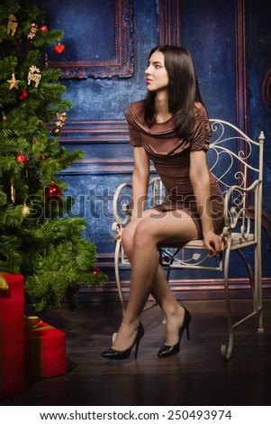 Beautiful brunette in the christmas interior