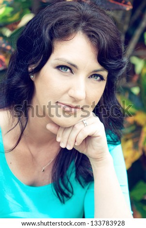 Beautiful brunette in the park - stock photo