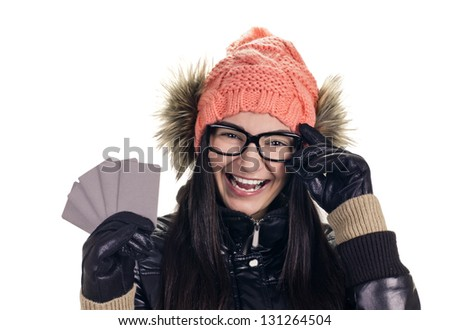 beautiful brunette in winter clothes with card like credit on white