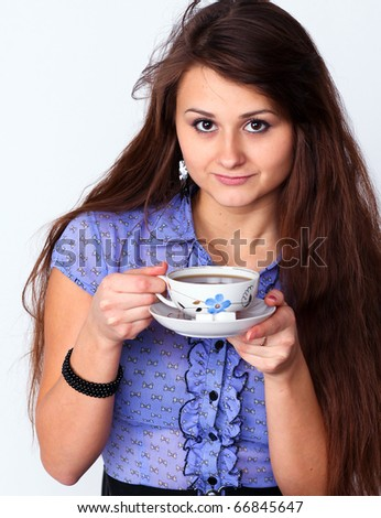 Beautiful brunette lady drinking bracing coffee