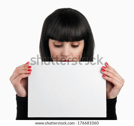 Beautiful brunette looking at sheet of paper, isolated on white background