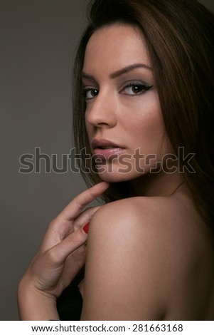 Beautiful brunette looking glamorous - stock photo