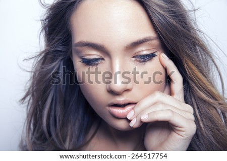Beautiful brunette model with long  hair and make up. studio shot. horizontal. - stock photo