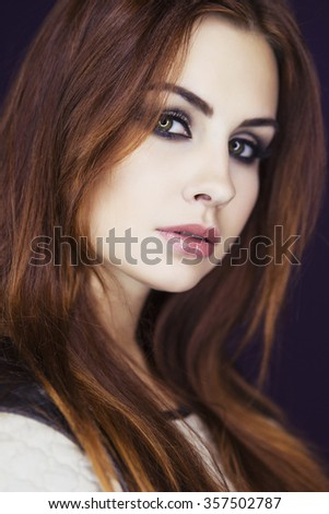 Beautiful brunette model woman in dress and with evening creative smokey make up. Looking sideways (down).  Clean fresh skin